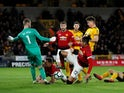 Manchester United's Chris Smalling scores an own goal against Wolverhampton Wanderers in the Premier League on April 2, 2019.