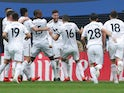 Matt Doherty is mobbed by his Wolverhampton Wanderers teammates after opening the scoring against Watford at Wembley on April 7, 2019