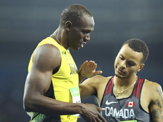 Andre De Grasse with Usian Bolt at 2016 Olympic Games in Rio de Janeiro.
