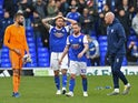 Ipswich Town's Bartosz Bialkowski, Luke Chambers, Alan Judge, James Collins and Myles Kenlock look dejected at the end of the match as they are relegated to League One on April 13, 2019