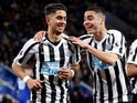 Ayoze Perez celebrates with Miguel Almiron after scoring for Newcastle United on April 12, 2019