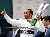 Lewis Hamilton celebrates winning the Chinese Grand Prix on April 14, 2019