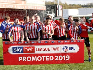 Lincoln promoted to League One despite Cheltenham draw