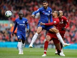 Chelsea's Ruben Loftus-Cheek is challenged by Liverpool's Joel Matip in the Premier League at Anfield on April 14, 2019