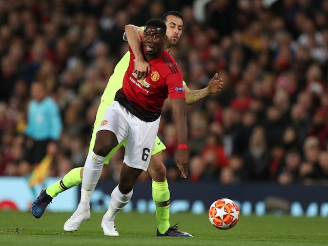 Barcelona's Sergio Busquets in action with Manchester United's Paul Pogba in the Champions League on April 10, 2019
