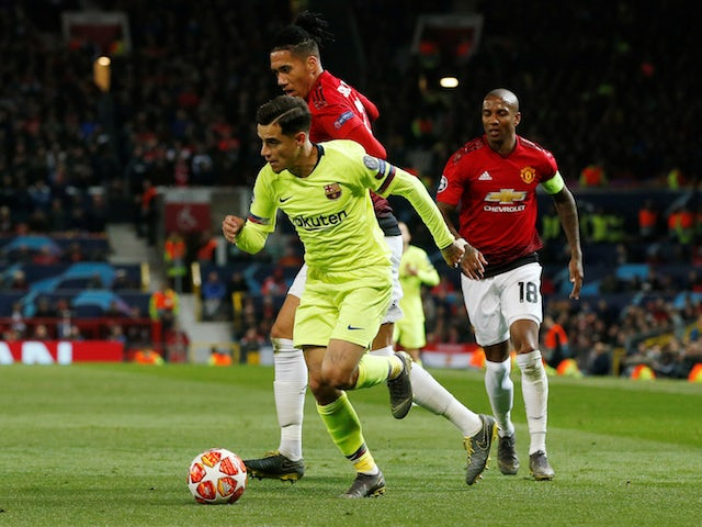 Barcelona's Philippe Coutinho runs away from Manchester United's Chris Smalling in the Champions League on April 10, 2019