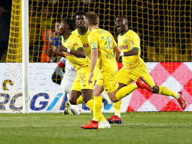 Anthony Limbombe celebrates with Nantes teammates after scoring on April 12, 2019