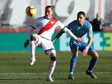 Rayo Vallecano's Raul de Tomas in action with Atletico Madrid's Jose Gimenez in February 2019