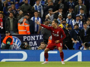 Liverpool striker Roberto Firmino celebrates scoring against Porto on April 9, 2019