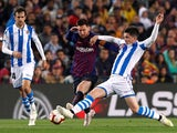 Barcelona's Lionel Messi in action with Real Sociedad's Igor Zubeldia on April 20, 2019