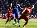 Bruno Ecuele Manga and Mohamed Salah in action during the Premier League game between Cardiff City and Liverpool on April 21, 2019