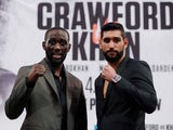Terence Crawford and Amir Khan pose on April 17, 2019