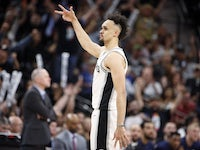 San Antonio Spurs point guard Derrick White (4) reacts after his three point basket against the Denver Nuggets in game three of the first round of the 2019 NBA Playoffs at AT&T Center on April 19, 2019