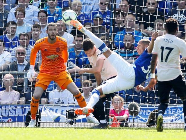 Everton's Richarlison scores a scissor kick against Manchester United in the Premier League on April 21, 2019.