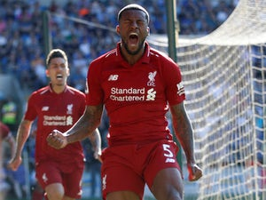 Record-breaking Liverpool regain top spot with Cardiff win