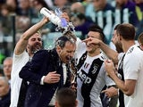 Juventus players pour water on Massimiliano Allegri after they win the Serie A title on April 20, 2019