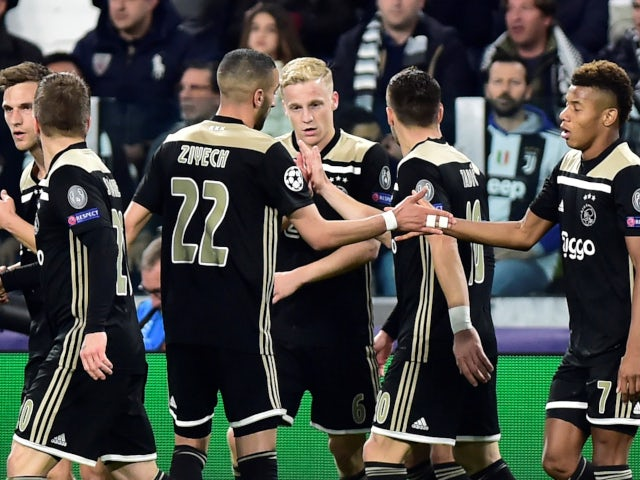 Ajax's Donny van de Beek celebrates with his teammates after equalising against Juventus on April 16, 2019