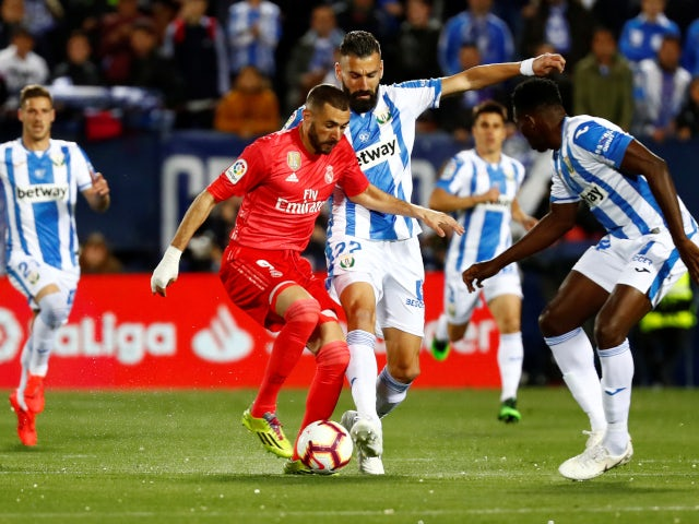 Real Madrid's Karim Benzema in action with Leganes' Dimitris Siovas on April 15, 2019