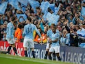 Manchester City players celebrate Raheem Sterling's goal against Tottenham Hotspur in the Champions League on April 27, 2019