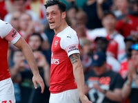 Mesut Ozil celebrates his equaliser during the Premier League game between Arsenal and Crystal Palace on April 21, 2019