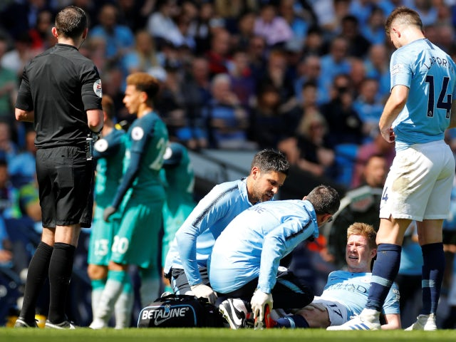 Manchester City's Kevin De Bruyne receives treatment after suffering an injury against Tottenham Hotspur in the Premier League on April 20, 2019.