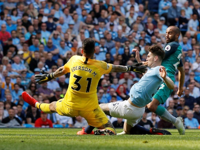 Tottenham Hotspur's Lucas Moura is denied by Manchester City's defence in the Premier League on April 20, 2019.