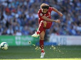 Mohamed Salah takes a shot during the Premier League game between Cardiff City and Liverpool on April 21, 2019