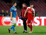Arsenal midfielder Aaron Ramsey hobbles off the field with a hamstring injury during the Europa League clash with Napoli on April 18, 2019