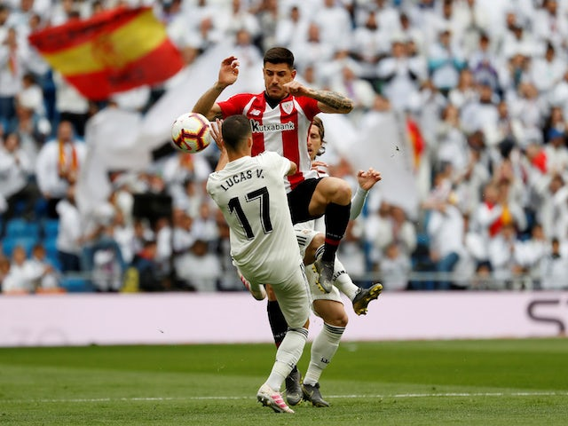 Real Madrid's Lucas Vazquez battles Athletic Bilbao's Yuri Berchiche for the ball in their La Liga clash on April 21, 2019
