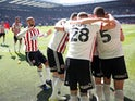 Sheffield United players celebrate scoring against Nottingham Forest on April 19, 2019