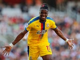 Wilfried Zaha celebrates putting his side back ahead during the Premier League game between Arsenal and Crystal Palace on April 21, 2019