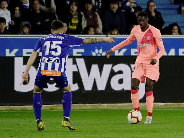 Barcelona's Ousmane Dembele in action with Alaves' Ximo Navarro on April 23, 2019