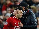 Liverpool manager Jurgen Klopp with Alex Oxlade-Chamberlain as he prepares to come on against Huddersfield on April 26, 2019