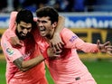 Barcelona's Luis Suarez and Carles Alena celebrate the opening goal against Alaves on April 23, 2019