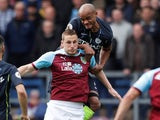 Vincent Kompany and Chris Wood in action during the Premier League game between Burnley and Manchester City on April 28, 2019