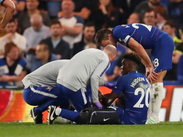 Chelsea's Callum Hudson-Odoi receives treatment after rupturing his Achilles against Burnley in the Premier League on April 22, 2019.