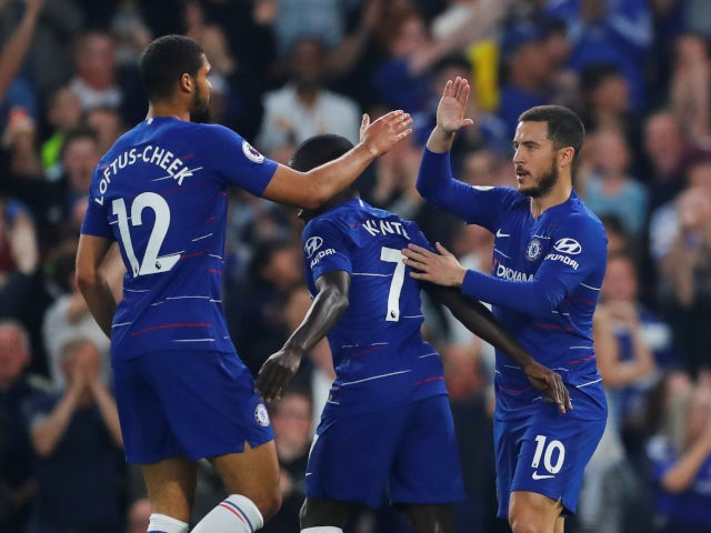 Chelsea's players celebrate N'Golo Kante's goal against Burnley on April 22, 2019