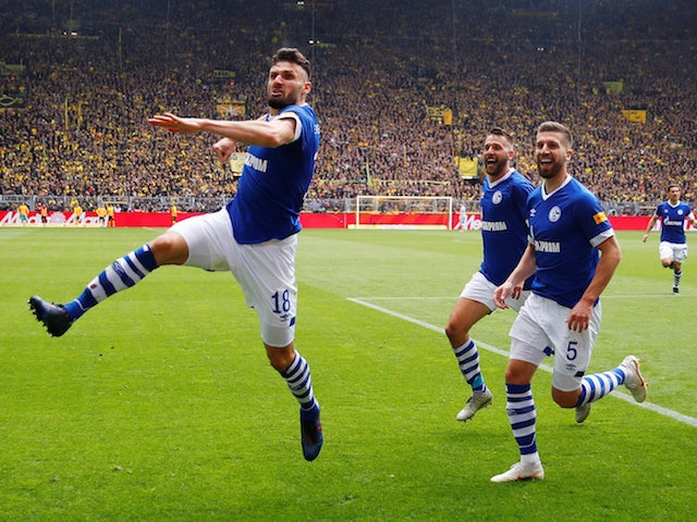 Result: Title-chasing Dortmund slump to damaging defeat in ill-tempered Ruhr derby