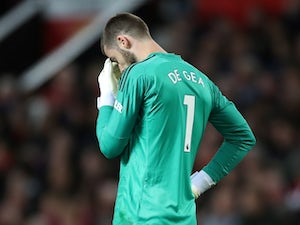 Manchester United goalkeeper David de Gea reacts after his howler against Manchester City on April 24, 2019