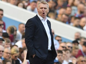 Aston Villa manager Dean Smith watches his cat do a whoopsie on his beret on April 22, 2019