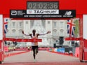 Kenya's Eliud Kipchoge celebrates winning the men's elite race at the 2019 London Marathon on April 28, 2019