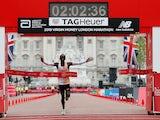 Kenya's Eliud Kipchoge celebrates winning the men's elite race at the 2019 London Marathon on April 28, 2019