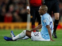 Manchester City midfielder Fernandinho goes down injury during the derby against Manchester United on April 24, 2019