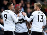 Fulham's Ryan Babel celebrates scoring their first goal against Cardiff with Aleksandar Mitrovic and Tim Ream on April 27, 2019