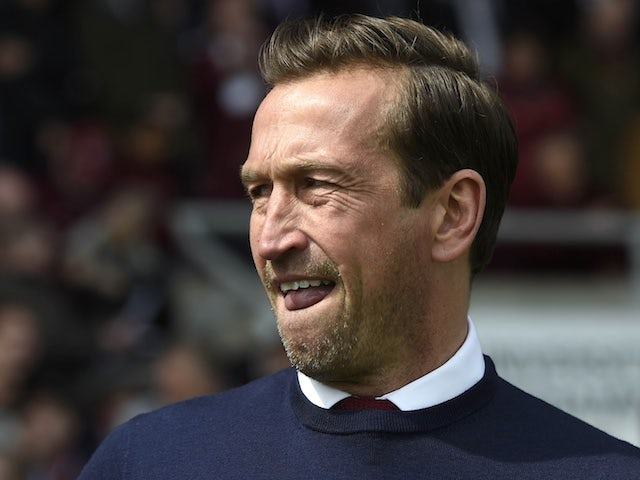 Justin Edinburgh: Emotional Orient players lay dugout tributes to late 'gaffer'