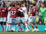 Leeds and Aston Villa players scrap during their Championship clash on April 28, 2019