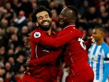 Naby Keita celebrates scoring with Mohamed Salah during the Premier League game between Liverpool and Huddersfield Town on April 26, 2019