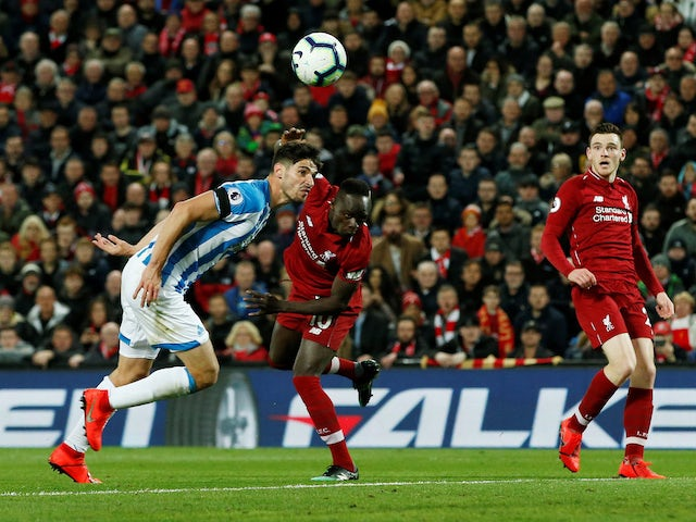 Sadio Mane scores the fourth during the Premier League game between Liverpool and Huddersfield Town on April 26, 2019