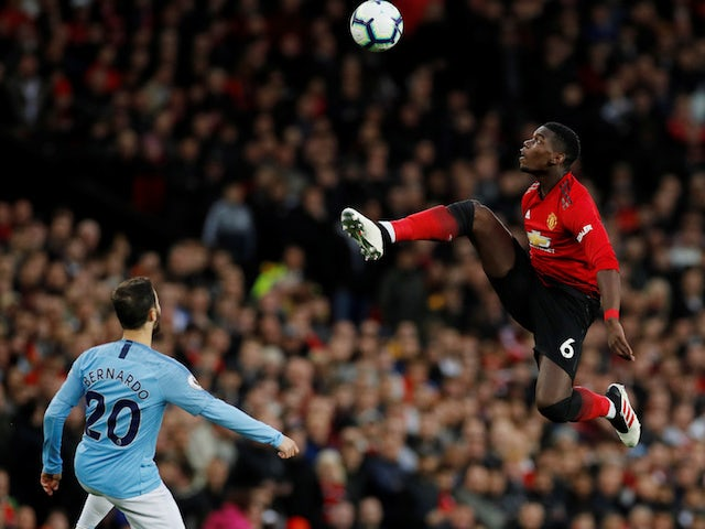 Manchester United midfielder Paul Pogba gets to the ball ahead of Manchester City's Bernardo Silva on April 24, 2019