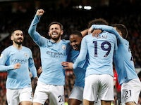 Manchester City players celebrate scoring their second goal against Manchester United on April 24, 2019